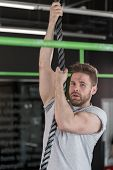 picture of rope pulling  - Handsome strong man pulling - JPG