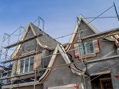 picture of scaffold  - Scaffolds surrounding home following application of smooth exterior stucco but prior to painting - JPG