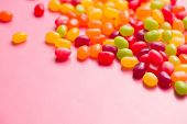 stock photo of jelly beans  - the jelly beans on pink background - JPG