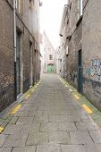 foto of paving stone  - Empty and Paved Stone Alleyway with No People - JPG