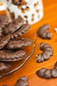 stock photo of biscuits  - Coffee and delicious chocolate biscuits on table closeup - JPG