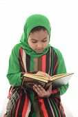 picture of muslimah  - Little Young Muslim Girl Reading Book of Quran Isolated on White Background - JPG