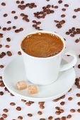 pic of sugar cube  - Fresh brewed coffee mug with sugar cubes and coffee beans on background - JPG