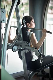 image of cardio exercise  - Woman weight training at gym - JPG