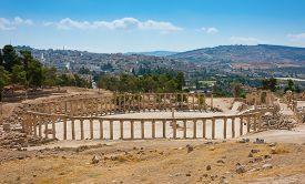 stock photo of cardo  - Ruins of the Forum Cardo at Jerash Jordan with modern city view - JPG
