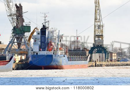 Cargo Ship Loading In Port By Wintertime