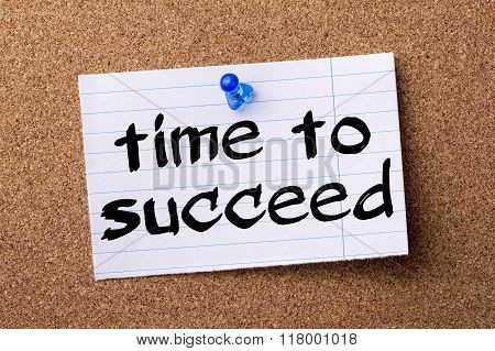 Time To Succeed - Teared Note Paper  Pinned On Bulletin Board