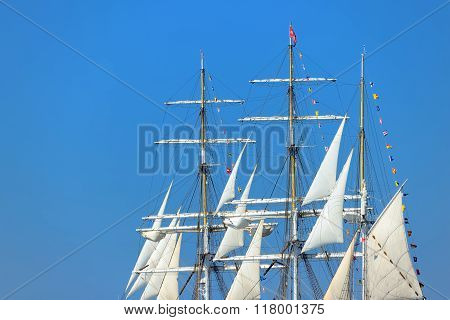 Close-up Of An Old Historical Tall Ship Masts With White Sails