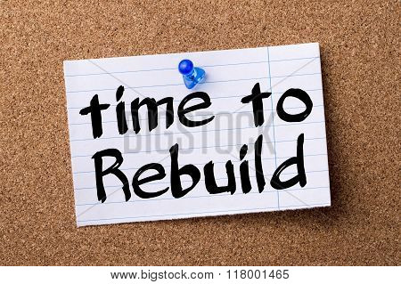 Time To Rebuild - Teared Note Paper  Pinned On Bulletin Board