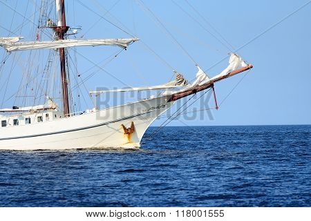 Close-up Of An Old Historical Tall Ship With White Sails In Blue Sea