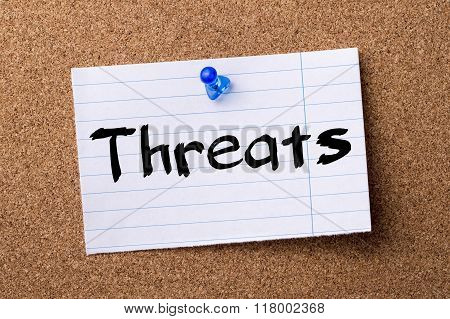 Threats - Teared Note Paper  Pinned On Bulletin Board
