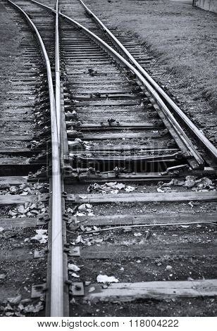 Line of railway crossing black and white image