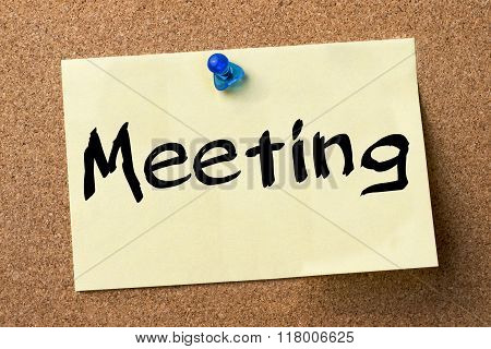 Meeting - Adhesive Label Pinned On Bulletin Board