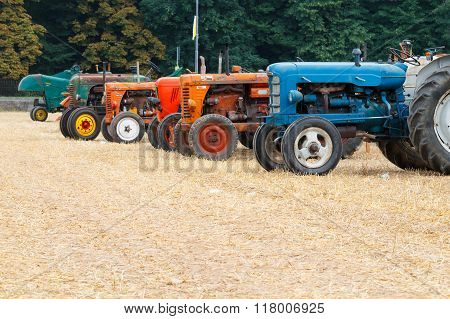 Detail of old tractors in perspective agricultural vehicle rural life