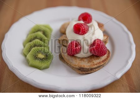 Home made pancakes with cream and fresh fruit