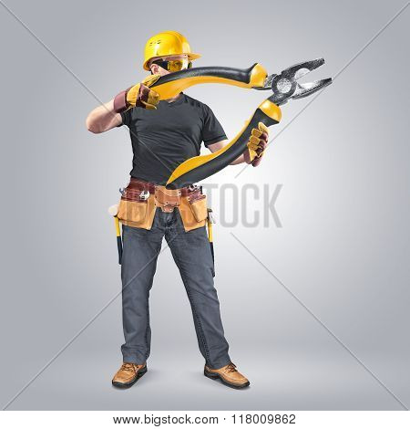 construction worker with tool belt and pliers