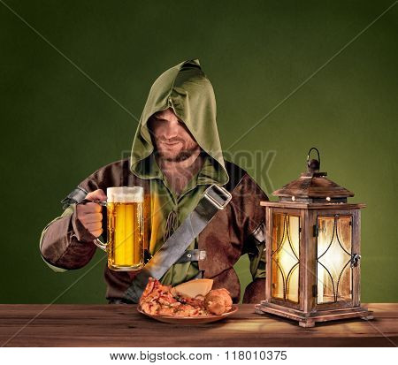 medieval man in a tavern with a beer on the vintage background