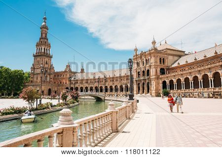 Tourists walking around famous landmark - the Plaza de Espana in