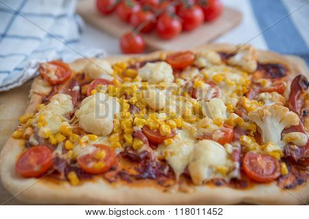 Home made pizza with tomatoes