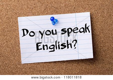 Do You Speak English? - Teared Note Paper  Pinned On Bulletin Board