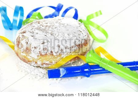 paczki with party horns on white