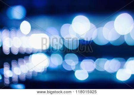 Blue Bokeh Lights On Dark Background