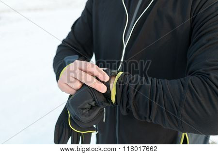Runner Using Smartwatch. Outside, Snow, Winter