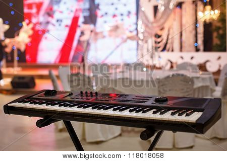 Piano Keyboard synthesizer in  festive room,Front view