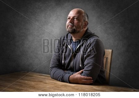Man Sitting On Table
