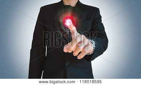 Businessman pushing digital holographic interface screen