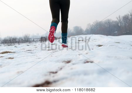 Woman Running On The Snow