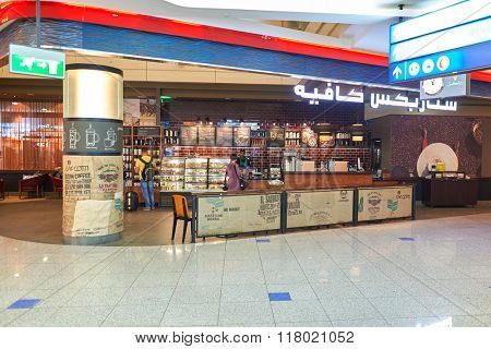 DUBAI, UAE - SEPTEMBER 08, 2015: Starbucks cafe in Dubai Airport. Starbucks Corporation is an American coffee company and coffeehouse chain.
