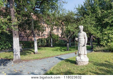 Courtyard Garden With Statue And Old Historic Houses Of Beguinage In Antwerp, Belgium