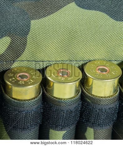 Hunting Cartridges, Close Up. Camouflage Background