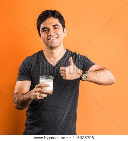 indian man with a glass of milk, asian man with a glass of milk, indian boy drinking milk, asian boy