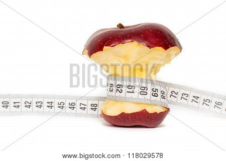 Healthy Bitten Red Apple With Measuring Tape