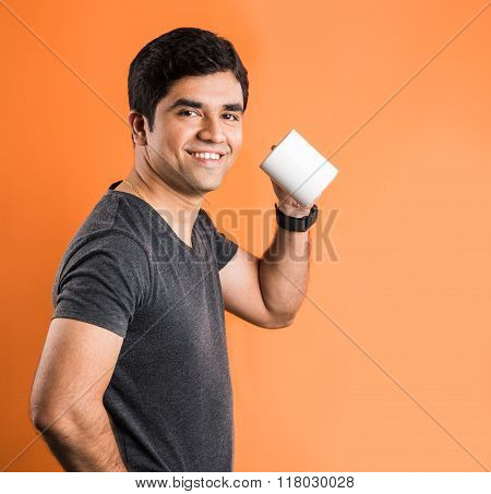indian man with coffee mug, indian man drinking coffee, indian man drinking tea, asian man having te
