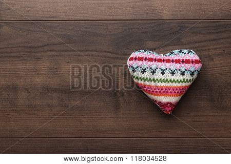 knitted plush heart shape on the table