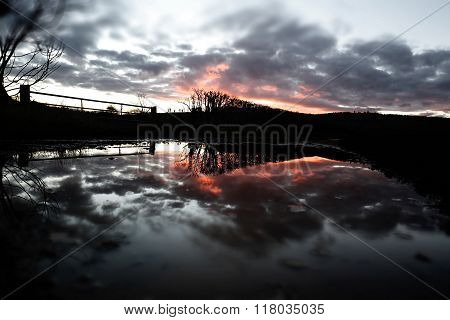 Fiery Sunset Reflection & Flooding After Storm Imogen