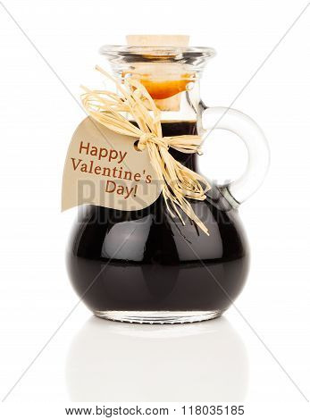 Maple Syrup In Glass Bottle Or Herbal Syrup, Ardent Drink, Mixture, With Heart Label. On White Backg