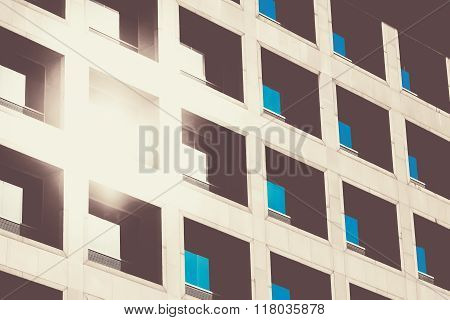 The Reflection Of The Sun And Blue Sky Mirrored In A Modern Buil