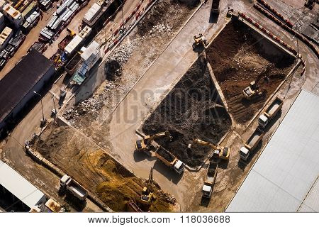 Excavators And Tipper Trucks Working At Construction. Hong Kong