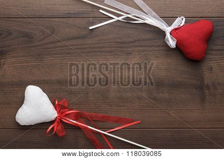red and white plush heart shapes on sticks