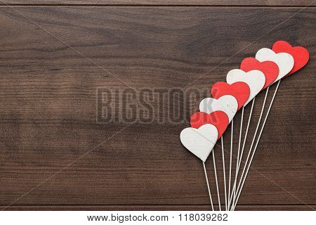 red and white heart shapes on sticks