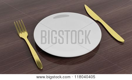 Golden fork and knife with a plate, set on wooden surface.