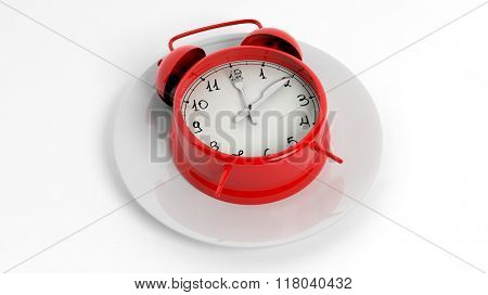 Red alarm clock with fork and knife pointers on plate, isolated on white background.