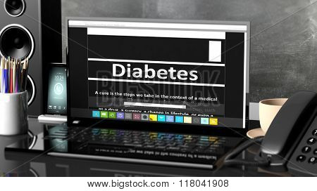 Laptop with Diabetes information on screen, on desktop with office objects.