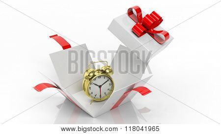 Golden alarm clock in open gift box, isolated on white background