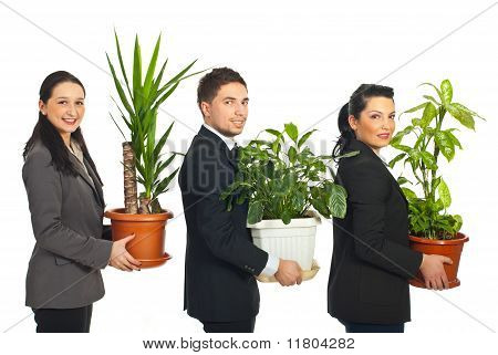 Line Of Business People Holding Plants