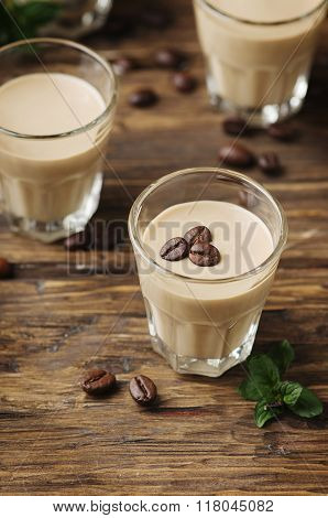 Cold Cream With Coffee And Mint On The Wooden Table